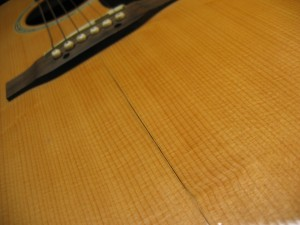 An Acoustic Guitar - Cracked From Drying Out